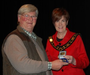 Councillor Noreen McCelland presents Edwin Bailey LIPF with his winning medal